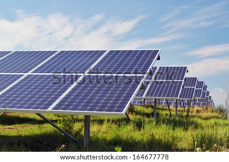 solar panels on field - stock photo