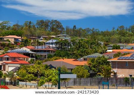 Solar panels on homes in Australian suburb - stock photo