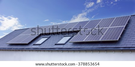Solar Panels On House Roof. Sustainable Renewable Energy - stock photo