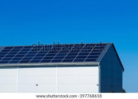 solar panels on large roof, factory building - stock photo