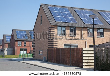 Solar panels on newly build houses - stock photo