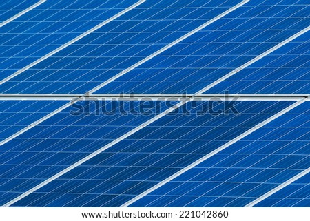 Solar panels on roof generating electricity close up. Sustainable green energy.