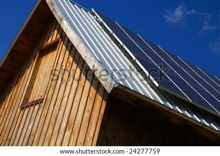 Solar panels on roof of barn - stock photo