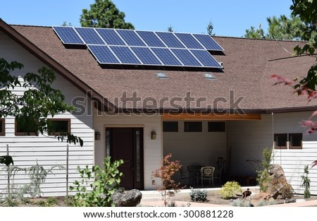 solar panels on roof of house - stock photo