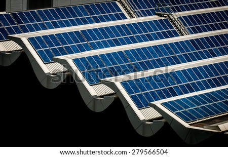 Solar panels on rooftop. Banks of solar panels on rooftop of a building. Scientific, Technology, and Engineering solution to tapping electrical energy from the sun. Go Green! - stock photo