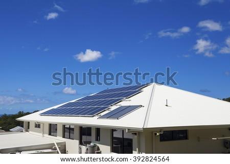 Solar panels on suburban home - stock photo