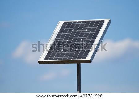 Solar panels on the blue sky - stock photo