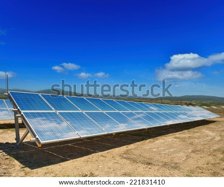 solar panels on the hilly terrain - stock photo
