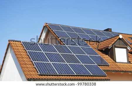 Solar panels on the house roof - stock photo
