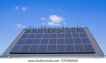 solar panels on the house roof with blue sky