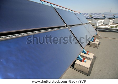 Solar panels on the roof a building - stock photo