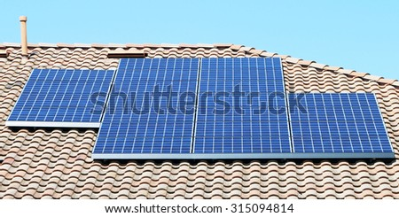 Solar panels on the roof of a suburban home in Southern California's Orange County. - stock photo