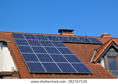 Solar panels on the roof of a  suburban house