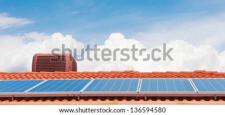 Solar panels on the roof of modern house - stock photo