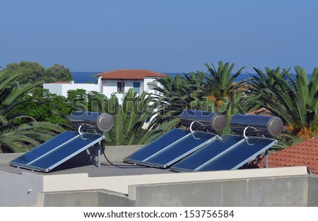 solar panels on the roof of the hotel - stock photo