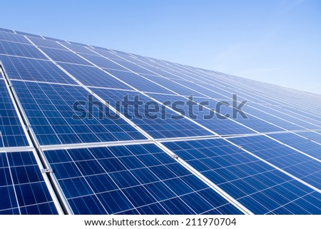 Solar panels on the sky background