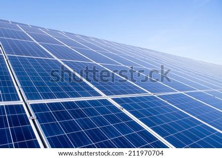 Solar panels on the sky background - stock photo