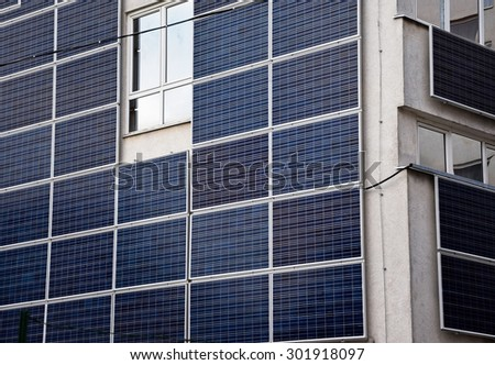 Solar panels on the wall of an office building