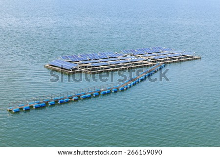 Solar panels on the water on daytime - stock photo