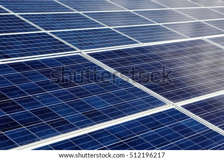 Solar panels or photo voltaic arrays arranged on the roof of a commercial business.