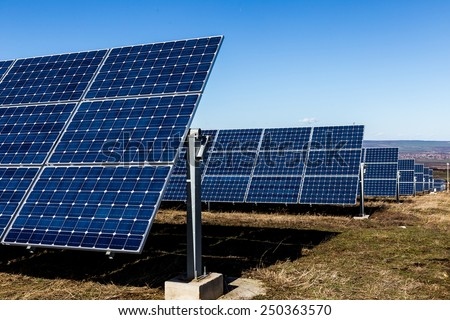 Solar panels plant in the countryside - stock photo
