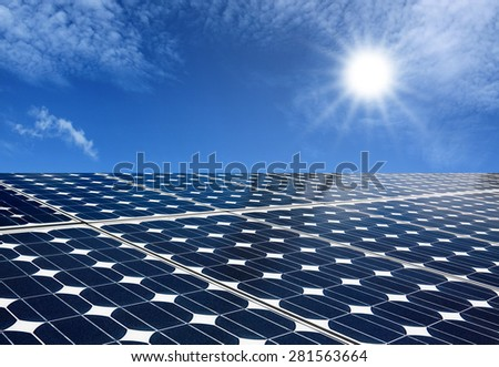 Solar panels produce energy from the sun with blue sky  - stock photo