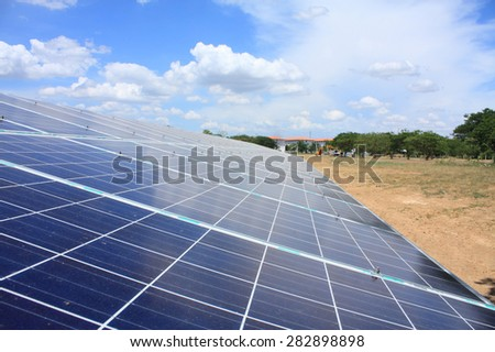 Solar panels produces green, environmental friendly energy from the setting sun - stock photo