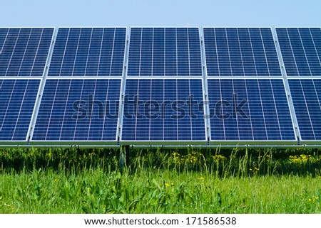 solar panels produces green, environmentally friendly energy from the sun - stock photo