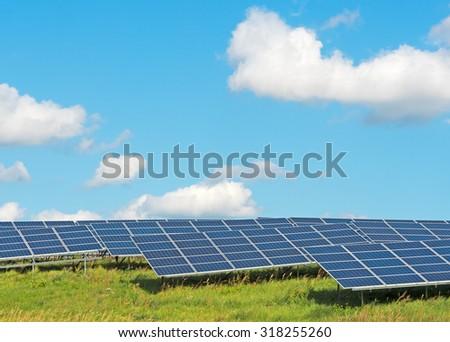 solar panels under a blue summer sky - stock photo