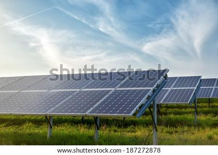 solar panels under blue sky - stock photo