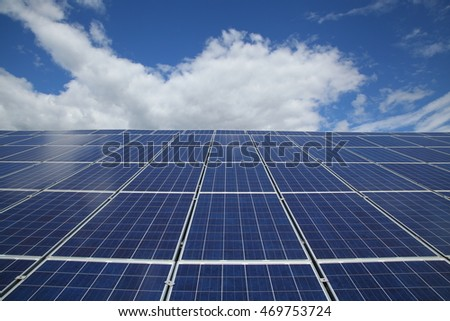 Solar panels used to generate electricity from sunlight against clouds and sky. In selected focus. Close-up.