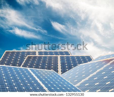 Solar panels with blue sky - stock photo
