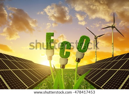 Solar panels with light bulbs on plant against sunset sky. The concept of sustainable resources.