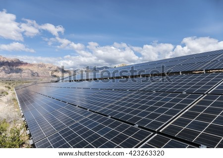 Solar panels with Mojave desert background at Red Rock Canyon National Conservation Area near Las Vegas, Nevada.   - stock photo