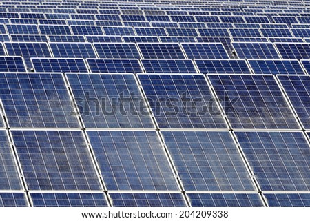 Solar panels with selective focus at the first rows - stock photo