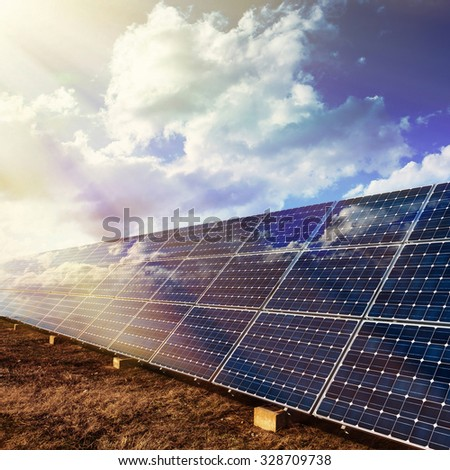 Solar panels with sunlight and sky background