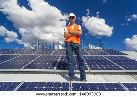 Solar panels with technician - stock photo