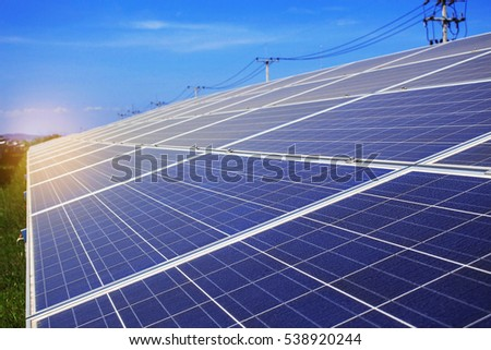 Solar panels with the blue sky.