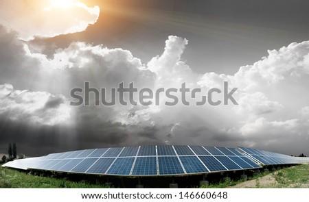solar panels with the sunny sky - stock photo