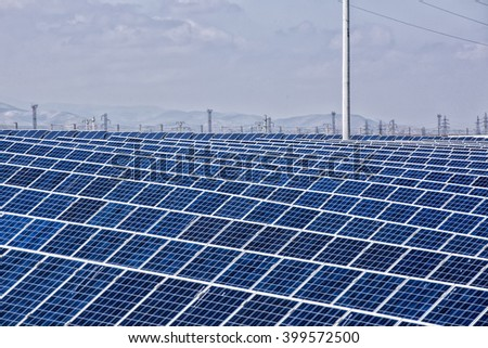 solar panels with the sunny sky. Blue solar panels. background of photovoltaic modules for renewable energy. - stock photo