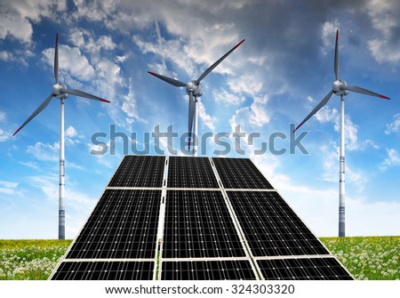 Solar panels with wind turbines in the setting sun. Concept of clean energy. - stock photo