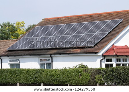 Solar photovoltaic panels on house roof - stock photo