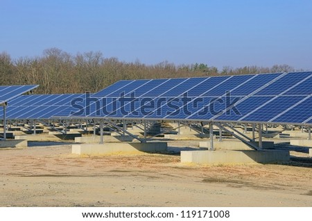 solar plant on field - stock photo