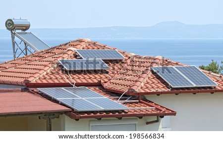 Solar power and hot water on a house - stock photo
