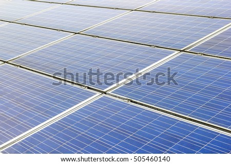 Solar power and photovoltaic panels under the blue sky white clouds.