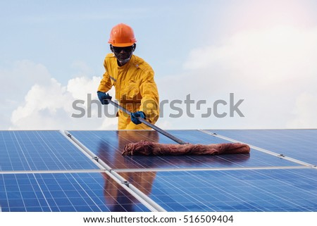 solar power engineering employee man Repair of solar cell.the concept of cleaning on solar cell.