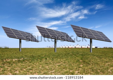 solar power on the prairie with mongolian yurts - stock photo