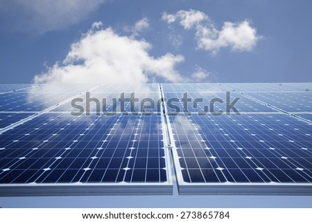 Solar power panel against blue sky - stock photo