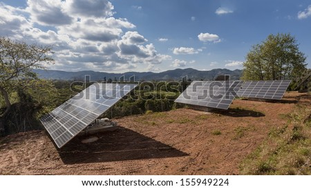 Solar power panels in a rural countryside in Greece - stock photo