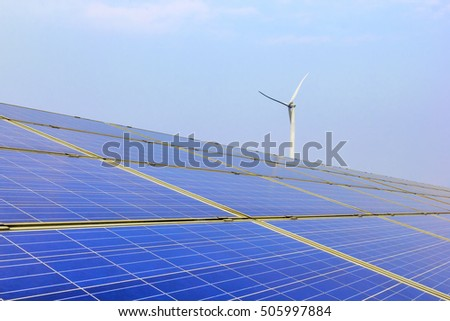 Solar power photovoltaic panels and wind generator under the blue sky white clouds.